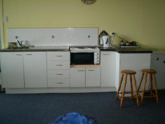 Unit has full cooking facilities, including sink, stove, toaster, kettle, etc