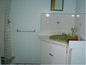 Bathroom is clean and modern with a well appointed shower.